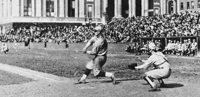 Lou Gehrig '23 swings for the fences, or maybe Journalism, as fans fill the bleachers on what now is Van Am Quad.