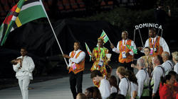 Runner Erison Hurtault '07 led Dominica's delegation on July 27 in the opening ceremony of the London 2012 Olympic Games. PHOTO: CHRISTOPHE SIMON/AFP/GETTYIMAGES