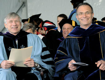Dean James J. Valentini (right) and President Lee C. Bollinger share a lighter moment during Class Day 2012. Eileen Barroso