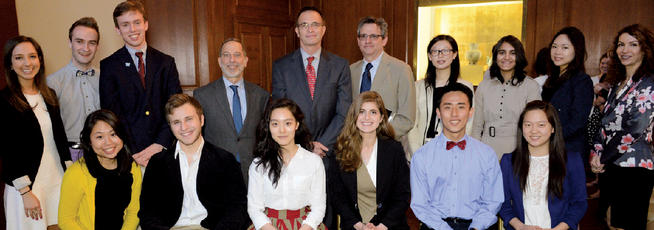 Award winners Rashid Khalidi, the Edward Said Professor of Modern Arab Studies, and Robert Friedman, a professor of mathematics, flank Dean James J. Valentini (top row, center), surrounded by Academics Awards Committee members.PHOTO: EILEEN BARROSO