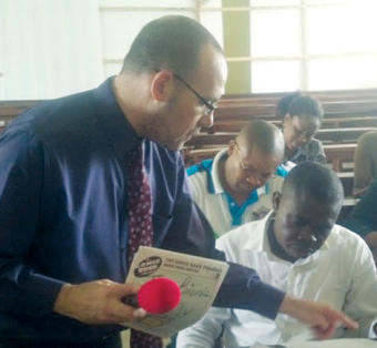 Michael Bitz '94, '98 TC works with teachers in Nigeria.
