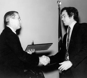 Snepp receives the CIA Medal of Merit in 1975 from CIA Director William E. Colby. PHOTO: COURTESY FRANK SNEPP '65, '68 SIPA