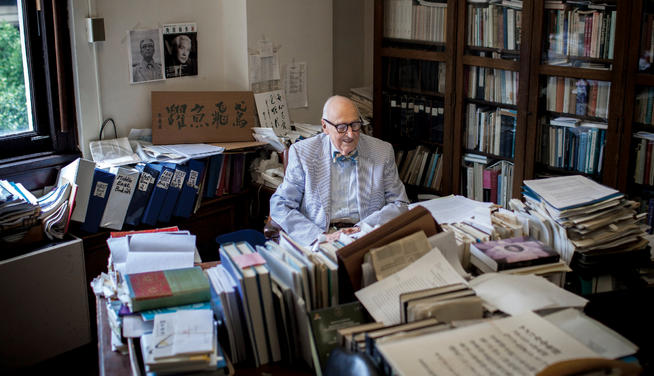 De Bary in his Kent Hall office, a virtual library of Asian philosophy and literature. PHOTO: NATALIE KEYSSAR