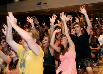 An enthusiastic audience of first-years participate in last year's Class Act in Alfred Lerner Hall. Photo: Char Smullyan