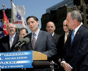 With Manhattan as a backdrop, Genachowski in May 2011 announced a new public safety system that sends geographically targeted alerts to enabled mobile devices. NYPD Commissioner Raymond Kelly and NYC Mayor Michael Bloomberg stand at far right. PHOTO: FCC
