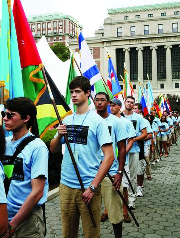 Orientation leaders march with flags from every state and country represented in the student body, part of the pageantry of Convocation.