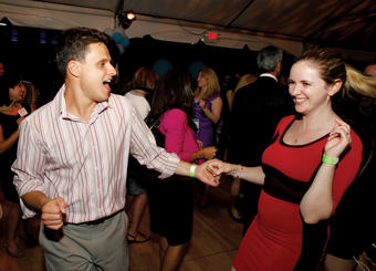 Two attendees get into the swing of things at the Starlight Reception. Photo: Eileen Barroso