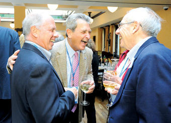 Members of the Class of 1962 share a laugh at their 50th reunion class dinner. Photo: Eileen Barroso