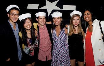 Young alumni party aboard the U.S.S. Intrepid. Photo: Michael DiVito