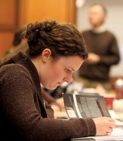 Anne Holt, a first-year graduate preceptor, takes notes at one of the weekly Lit Hum staff meetings. Photo: Bruce Gilbert