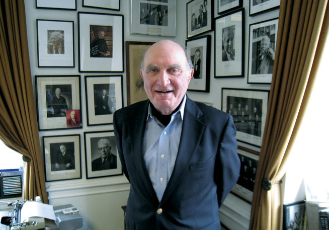 Photos on the walls of Norman Dorsen '50's office at NYU attest to the remarkable breadth of his career.Photo: Thomas F. Ferguson '74