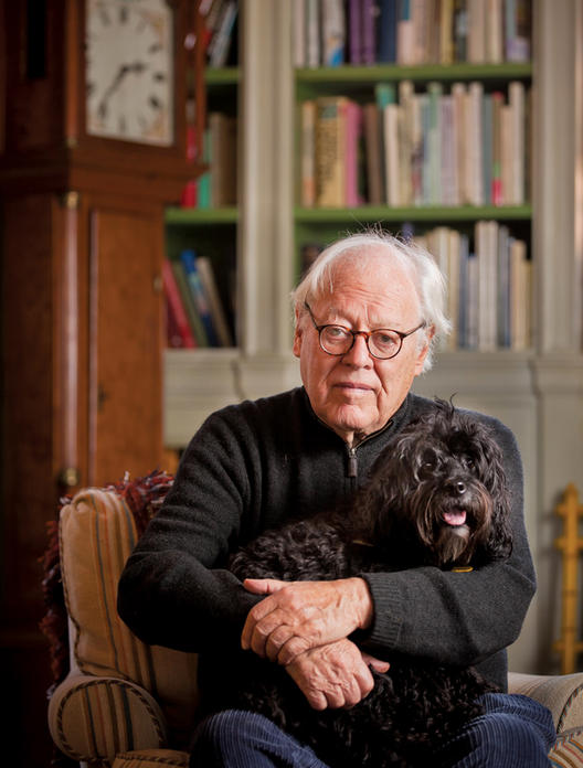Jason Epstein '49, '50 GSAS in his Centre Street living room with his 6-year-old cockapoo, Hamlet. Epstein's life's work as an editor and publisher can be seen in the thousands of books that fill his two homes. PHOTO: CHUCK ZOVKO