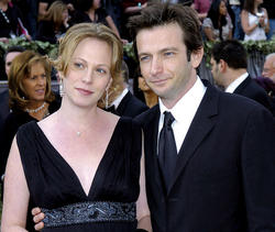 Dan Futterman '89 and his wife, Anya Epstein, pause on the red carpet prior to the 78th Academy Awards in Los Angeles on March 5, 2006. PHOTO: AP PHOTO/CHRIS PIZZELLO