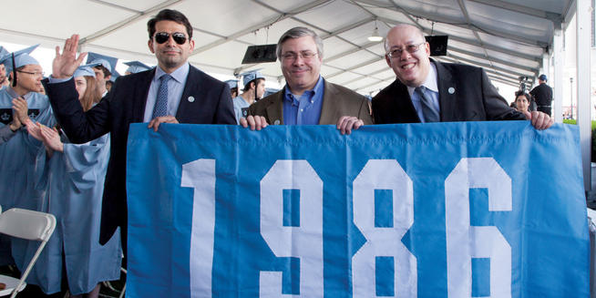 (Left to right) Hooman Mehran '86, Rick Wolf '86 and Mark Berman '86 proudly carry their class banner in this year's Alumni Parade of Classes at Class Day. PHOTO: SUSAN COOK