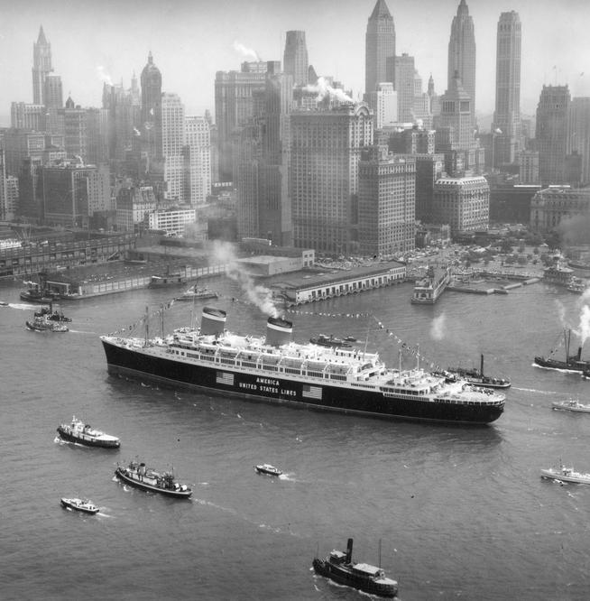 The S.S. America makes its way up the busy Hudson River in 1940,  steaming past the skyline of lower Manhattan.PHOTO: McLaughlin Air Service Photograph Collection, PR 043, Department of Prints, Photographs, and Architectural Collections, The New-York Historical Society