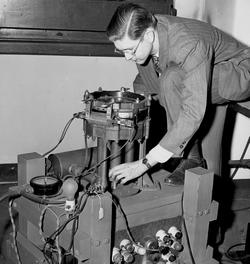 William W. Havens '46 GSAS, who began his career working on the Manhattan Project at Columbia and was for nearly two decades the University's director of nuclear science and engineering, scans the screen of a cloud chamber in Pupin, watching the tracks of nuclear particles. The chamber is an apparatus, weighing more than 300 lbs., for making visible the paths of submicroscopic nuclear particles. Photo: Manny Warman, Columbia University, Courtesy Columbia  University Archives