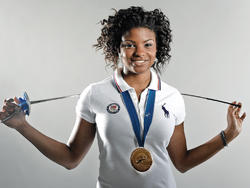 Fencer Nzingha Prescod '15, who is currently ranked No. 1 in the United States and eighth in the world, with her gold medal from the 2011 Junior World Championships, held in Amman, Jordan. Photo: Mike Dote