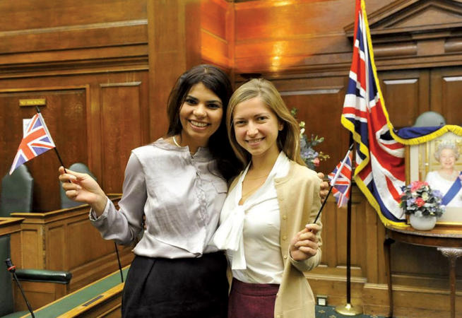 Ashleigh Silver '04 (right) and friend Ambica Shiringi celebrate their newly minted British citizenship in summer 2013. Photo: Courtesy Ashleigh Silver '04