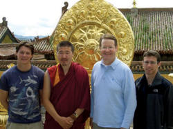 U.S. Ambassador to Mongolia Mark Minton '67 with the head monk of the Amarbayasgalant Monastery in 2008; they are flanked by Kevin Nolan '10 GS (right), who was interning at the U.S. Embassy in Mongolia, and a Peace Corps volunteer (left). Photo: Courtesy Mark Minton '67