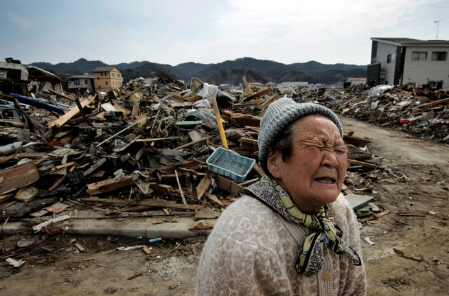 A woman whose house was washed away stands amidst debris in the Shinhamacyo area of Japan following the earthquake and tsunami of March 11.photo: Kuni Takahashi/Polaris