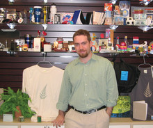 David Beatus '01 with some of Green Promos' offerings in the showroom of the company's Port Washington, N.Y., office.