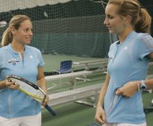 Ilene Weintraub '02 (left) shares advice about the game of tennis with Natalia Christenson '11 Barnard. PHOTO: Gene Boyars/Columbia University Athletics