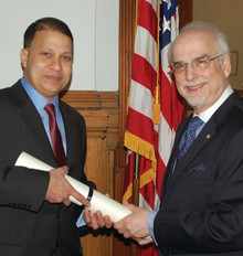 Jamsheed Choksy '85 (left) is sworn into office at the National Endowment of the Humanities on May 22 by Chairman Bruce Cole. Photo: NEH