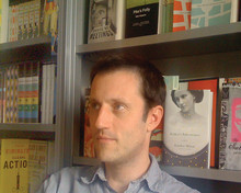Peter Mendelsund '91, shown in his office, happened upon his book design career serendipitously. Below, two of his cover designs.