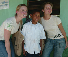 Ellen Gustafson '02 (left) and her business partner, Lauren Bush, pose with a beneficiary of the World Food Programme. Photo: Courtesy of the World Food Programme