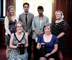 Katharina Volk (seated, left) received the Lionel Trilling Award and Jenny Davidson received the Mark Van Doren Award in Low Library on May 5. Joining them were (from left) Emelie Kogut '10, Nirvikar Jassal '10, Dean Michele Moody-Adams and Anna Malkan '11. Kogut, Jassal and Malkan were co-chairs of the Columbia College Academic Awards Committee, which selected the winners. PHOTO: TINA GAO '10 BARNARD