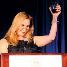 Cheryl Milstein '81 Barnard, toasting Quigley.PHOTO: Eileen Barroso