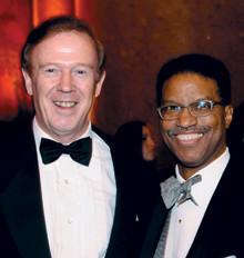 Quigley with University Trustee George Van Amson '74.PHOTO: Eileen Barroso