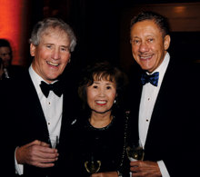 University Trustees Chair Bill Campbell '62 with Kassie and Carlos Muñoz '57.PHOTO: Eileen Barroso