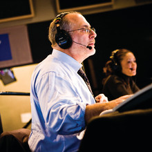 Siegel, with All Things Considered co-host Michelle Norris in the background, brought a personal touch to his network's coverge of the terrorist attack on the World Trade Center. Photo: © 2008 NPR, by Stephen Voss