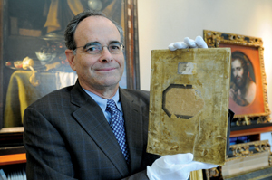 Thomas Kline '68, '75L holding the Augsburg Book of Nobles, a 16th-century book of German prints and drawings that turned up stolen in New York. Kline represented the German state of Baden-Wurttenburg and prevailed in getting the book returned. PHOTO: TOBIAS EVERKEM