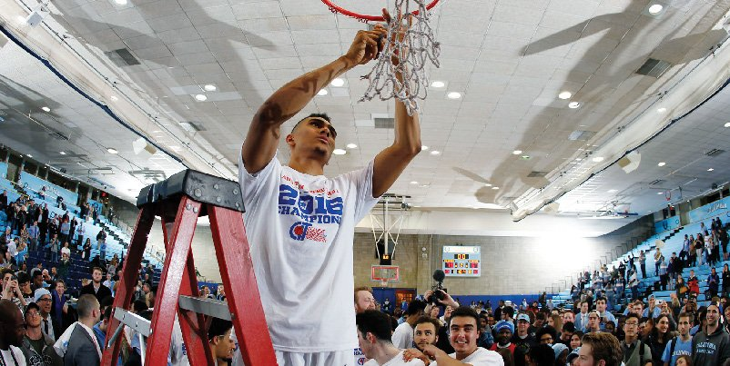 Maodo Lo '16 cuts down the net after winning the CIT championship.