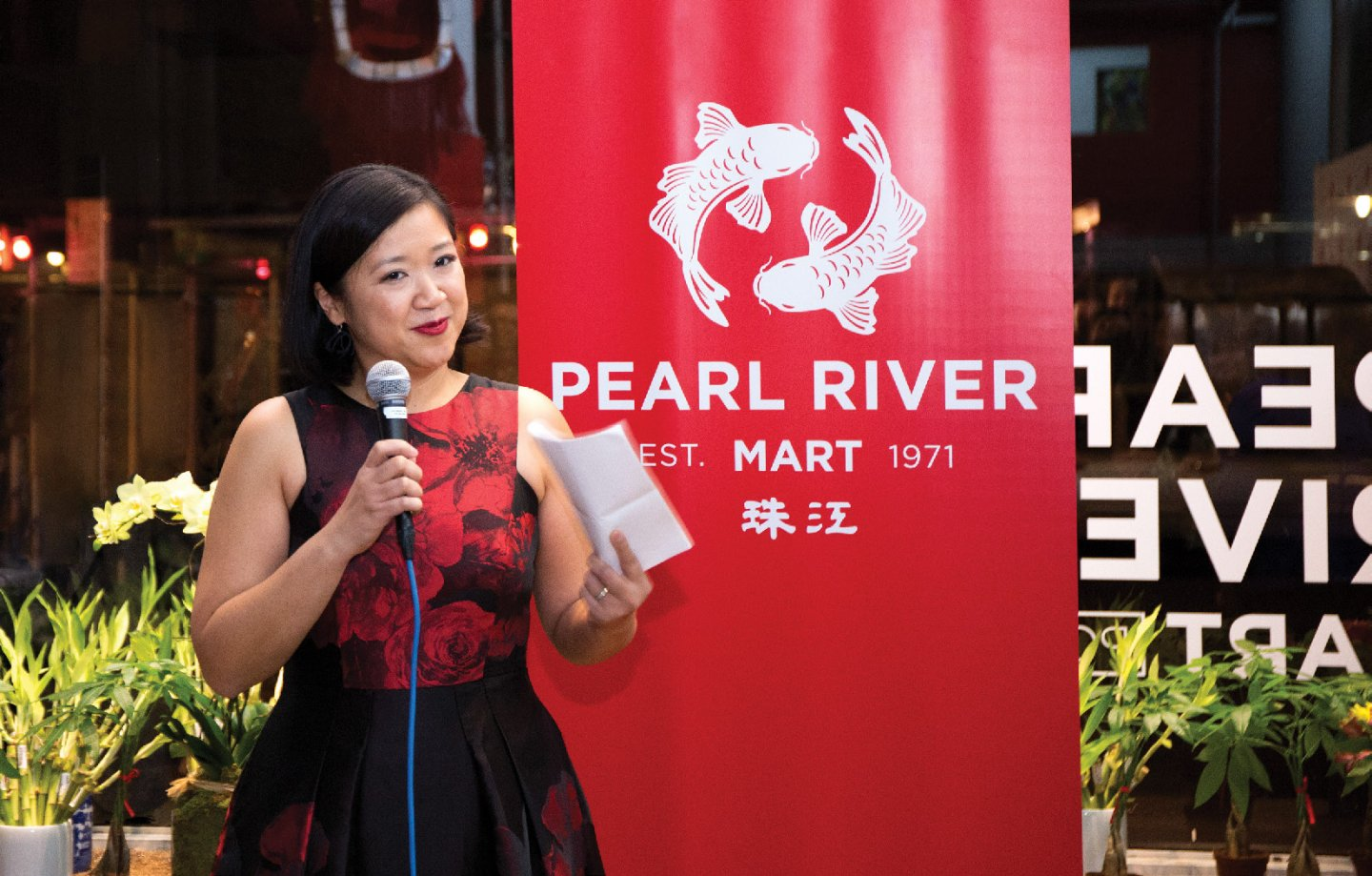 Joanne Kwong '97 speaks during the reopening of Chinatown's Pearl River Mart.