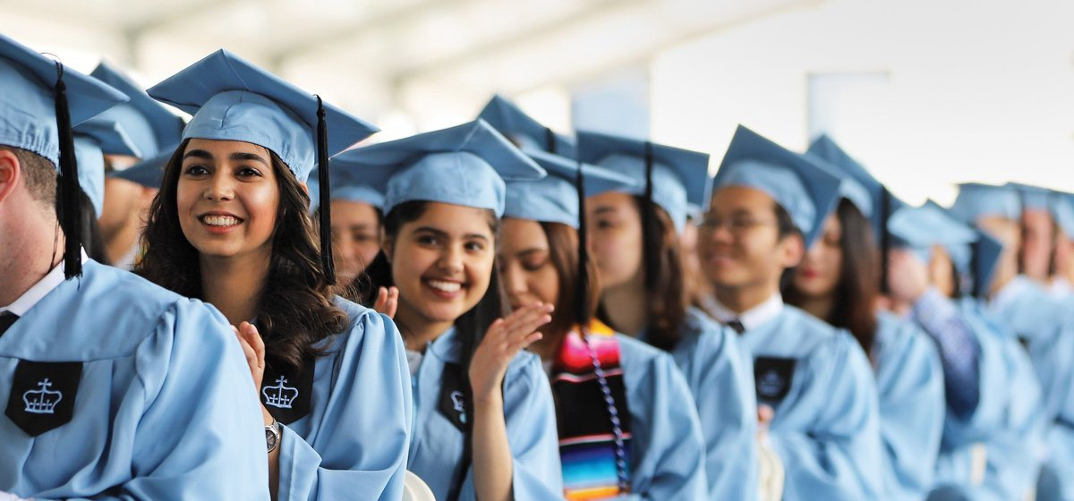 Columbia University students in their caps and gowns