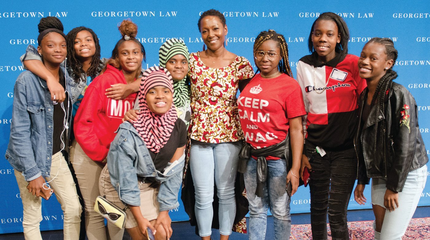 Monique W. Morris '94, GSAPP'96 with several young people
