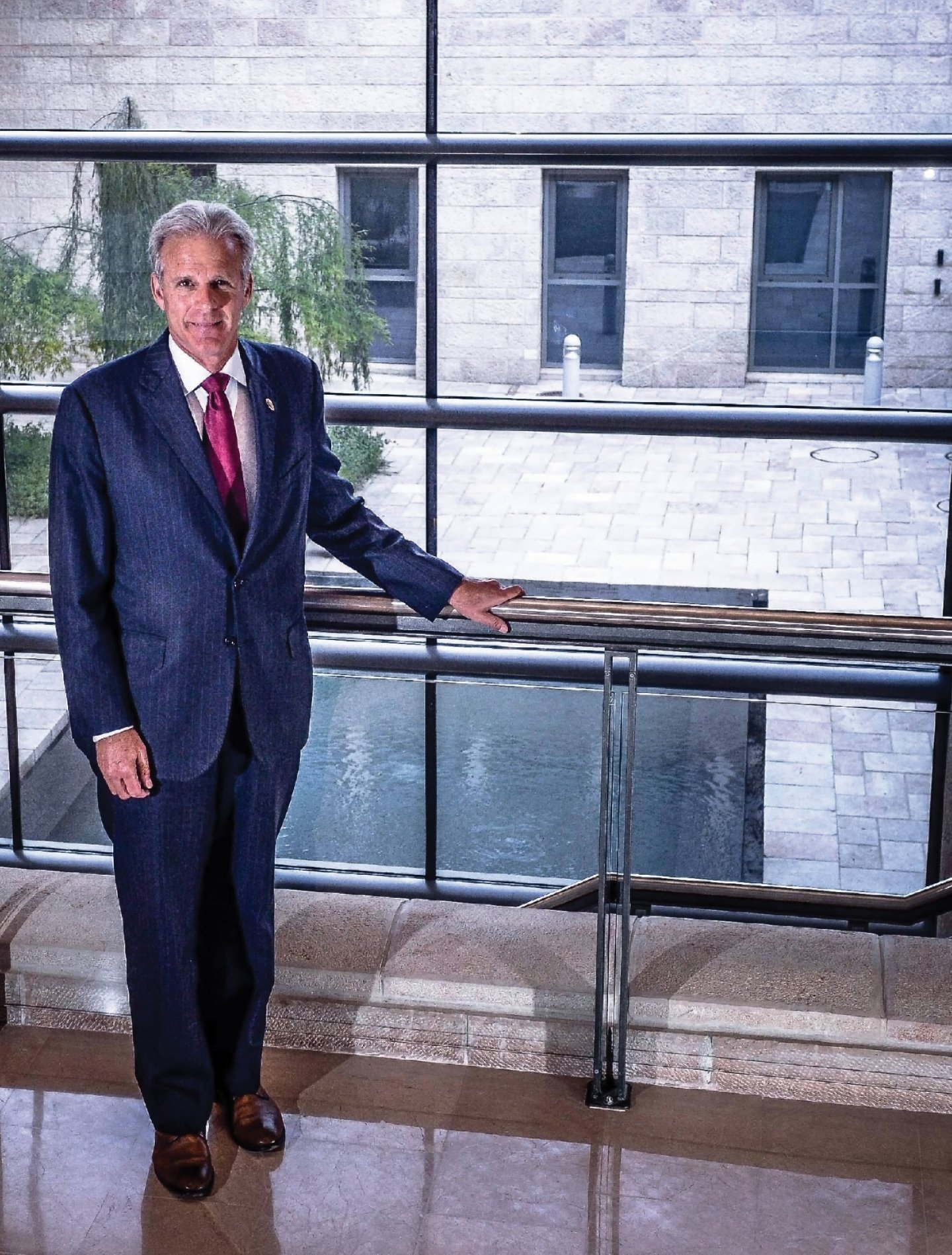 Michael Oren standing in front of a window