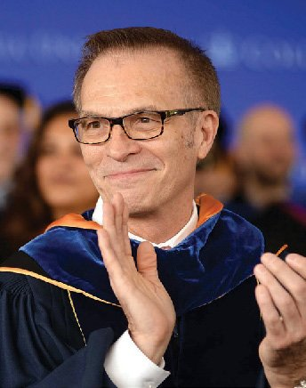 Columbia College Dean James J. Valentini applauds during Class Day.