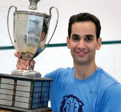 Osama Khalifa '18 poses with a trophy from the College Squash Association.