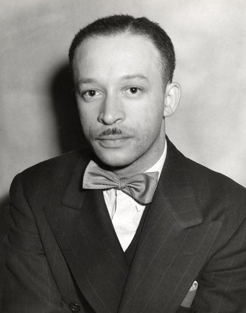 black and white photo of a man in a bow tie