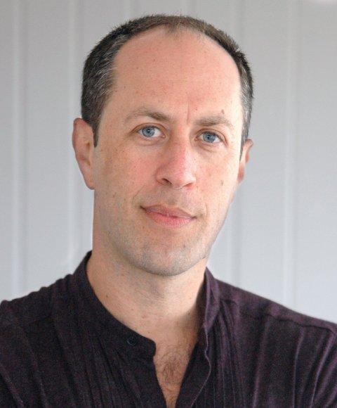 A man with short dark hair