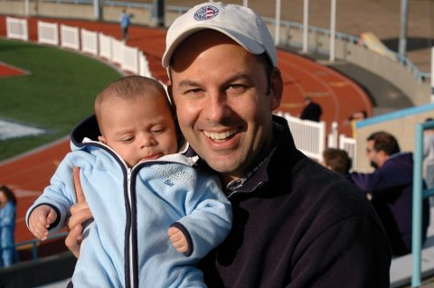 Michael Behringer '89 poses with a baby.