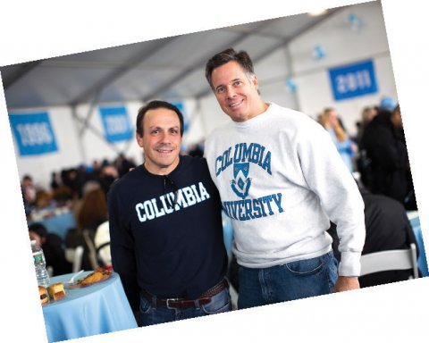 Two men wearing Columbia sweatshirts, smiling at the camera