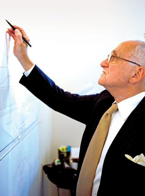 A man drawing on a vertical surface