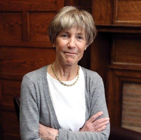 A woman in a grey cardigan