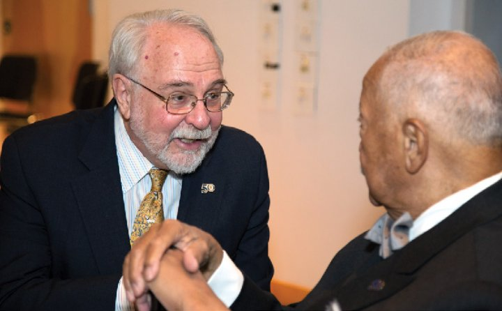 Roger Lehecka '67, GSAS'74 greets former NYC mayor David Dinkins at the Double Discovery Center ceremony renaming it in Lehecka's honor.
