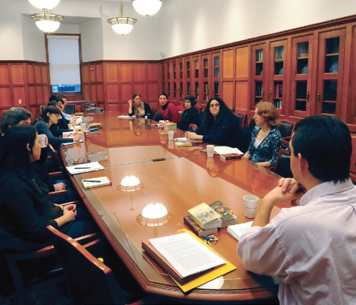 A group of men and women around a conference table